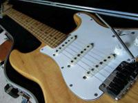 Here's a beautiful lightly flamed 93 Strat. I am not