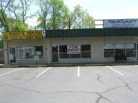 900 square feet in front of hectic strip center on