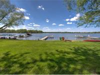 This delightful lakefront home is located on 75 of