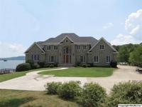 WATERFRONT ESTATE - $1,650,000  Premier stone home on