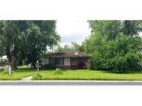 Excellent location on corner lot with large trees and