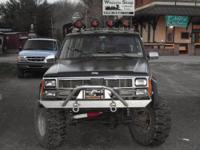 its lifted do not know how much but has 33 in tires has