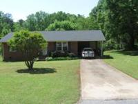 Our 2 bedroom, 1 bath brick home is on over 1 acre of