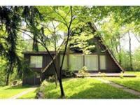 3,300SF contemporary A-frame and 1,900SF basement on