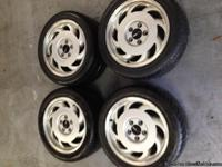 This is a set of 4 Chevrolet Corvette C4 wheels and