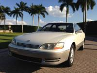 Lexus ES 300 White with gray shiny paint exterior.Black
