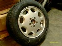 I have a used stock aluminum wheel with a new Michelin