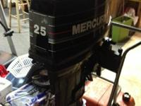 1993 Mercury 25 HP long shaft two stroke motor, tiller
