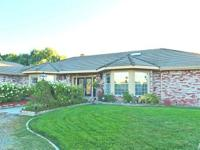 Gorgeous custom built home on 25.2 acres that offers a
