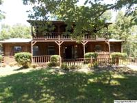 LOTS OF HOME AND LAND FOR THE $$$! Log home with over