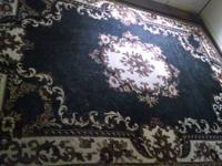 For sale is a gorgeous asian rug with black, cream, and