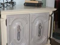 This is a solid wood cabinet that would work great as a