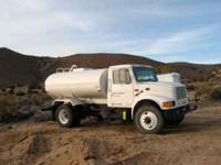 2000 GALLON, DIESEL, has front-rear-side spray and 1 ½