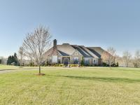 Absolutely gorgeous brick ranch located on 2.34+/-acres
