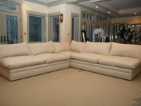 This is a lightly-used Corniche sectional sofa from