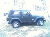2009 Jeep Wrangler X. Trail series. Dark green in