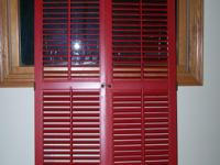 Two pairs of interior louvered wooden shutters. One