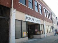 9,760 SF two-story retail area located on Poplar Street