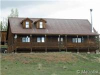 Cattle ranch home with loft space. Large covered