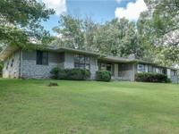 This beautiful 4 bed/2.5 bath home sits on 37 acres and