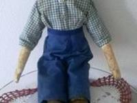 THIS DOLL WAS HAND CARVED BY EITHER MY GRANDFATHER OR