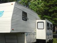 99 fifth wheel 30 foot with 20 foot slide out air