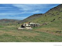 Magnificent custom home on a secluded 14 acre estate.