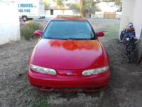 I have a 99 Oldsmobile Alero GLS, Red, with Sunroof.