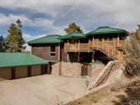"""CUSTOM DESIGNED """"PINEBLUFF LODGE"""" IS NESTLED IN THE"""