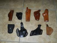 9 Used Leather Holsters, and leather Belt.  Holsters