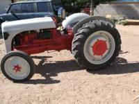A NICE 9N FORD TRACTOR W; NEW TIRES IN FRONT REAR TIRES