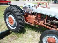 9N Ford Tractor, new rear tires, original paint,