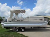 A 2004 Godfrey 220 RLE Pontoon garage kept. 115hp