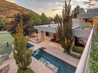This luxury home sits on nearly two acres adjacent BLM