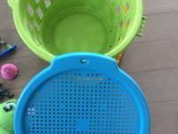 The basket and the toys as shown in the pictures. The