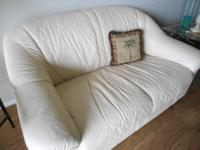 A Beautiful leather love-seat, Vanilla-beige color,