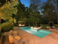 This gated 2+/- acre property of lush, mature