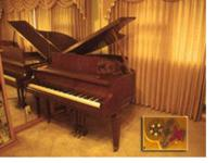 A 1969 classic, vintage, Chickering Baby Grand Piano.
