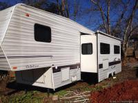 It is a white(make) coachmen (length)26foot