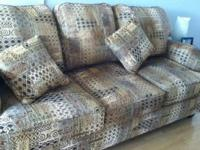 PRICED TO SELL, THIS LARGE COMFORTABLE SOFA HAS A