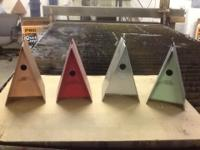 A-framed birdhouses made from 22 gauge metal.