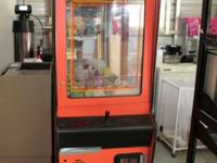 Arcade claw machine by A&G. This skill crane powers on,