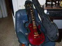 A real Gibson Les Paul Black case with combo lock. If