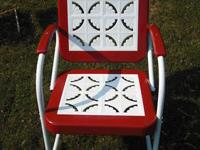 This is a pair of 1950's metal lawn chairs and table.
