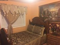 A peaceful and quiet furnished bedroom with shared