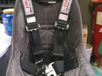 2 racing seats one with a 5 point harness and the other