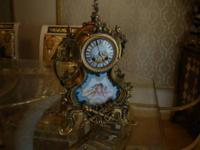 A spectacular antique 1878 French Japy clock with gold
