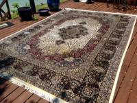 This Large Persian Design Rug is hand made and over $4K