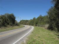 28.35 +/- acres of vacant commercial land and 1.5 +/-