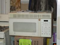 . MICROWAVE - Above Stove GE SpacemakerXL - $22. In